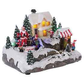 Village de Noël 15x20x15 cm lumières et mouvement piles s4