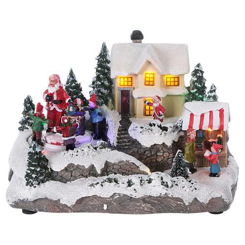 Village de Noël 15x20x15 cm lumières et mouvement piles 1