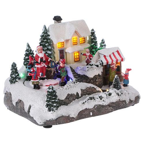 Village de Noël 15x20x15 cm lumières et mouvement piles 4