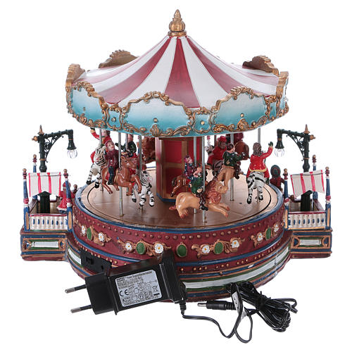 Christmas decoration carousel with lights, music and movement 25x30x30 cm 5