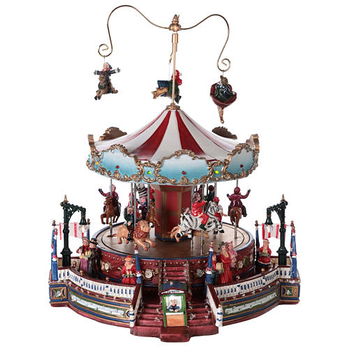 Christmas decoration carousel with lights, music and movement 25x30x30 cm 1