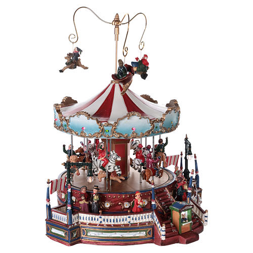 Christmas decoration carousel with lights, music and movement 25x30x30 cm 4