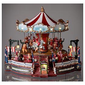 Décor de Noël avec carrousel mouvement lumières musique 25x30x30 cm courant s2