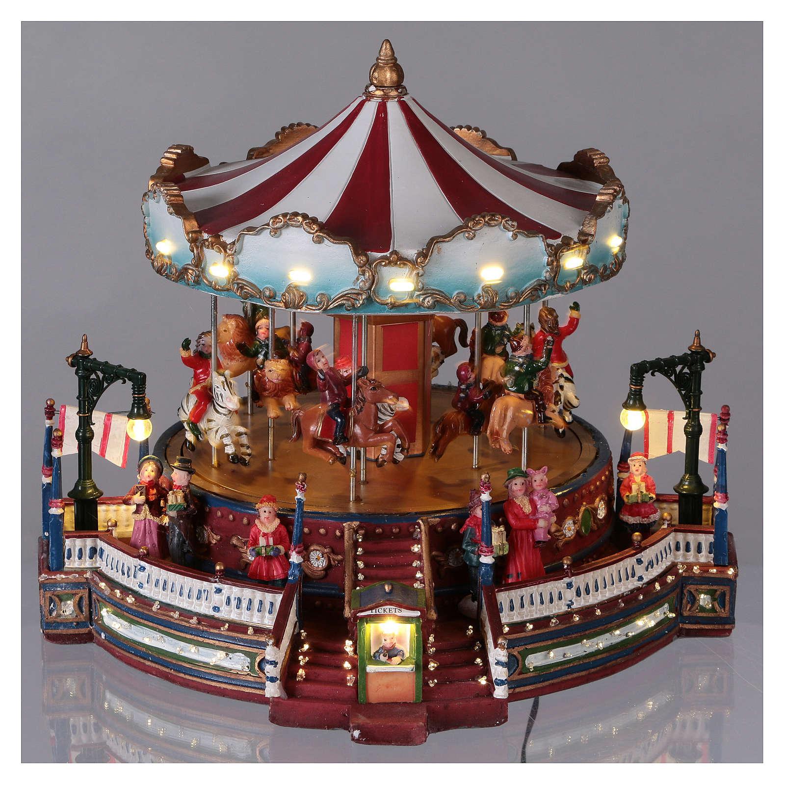Ambientazione natalizia con giostra movimento luci musica 25x30x30 cm corrente 3