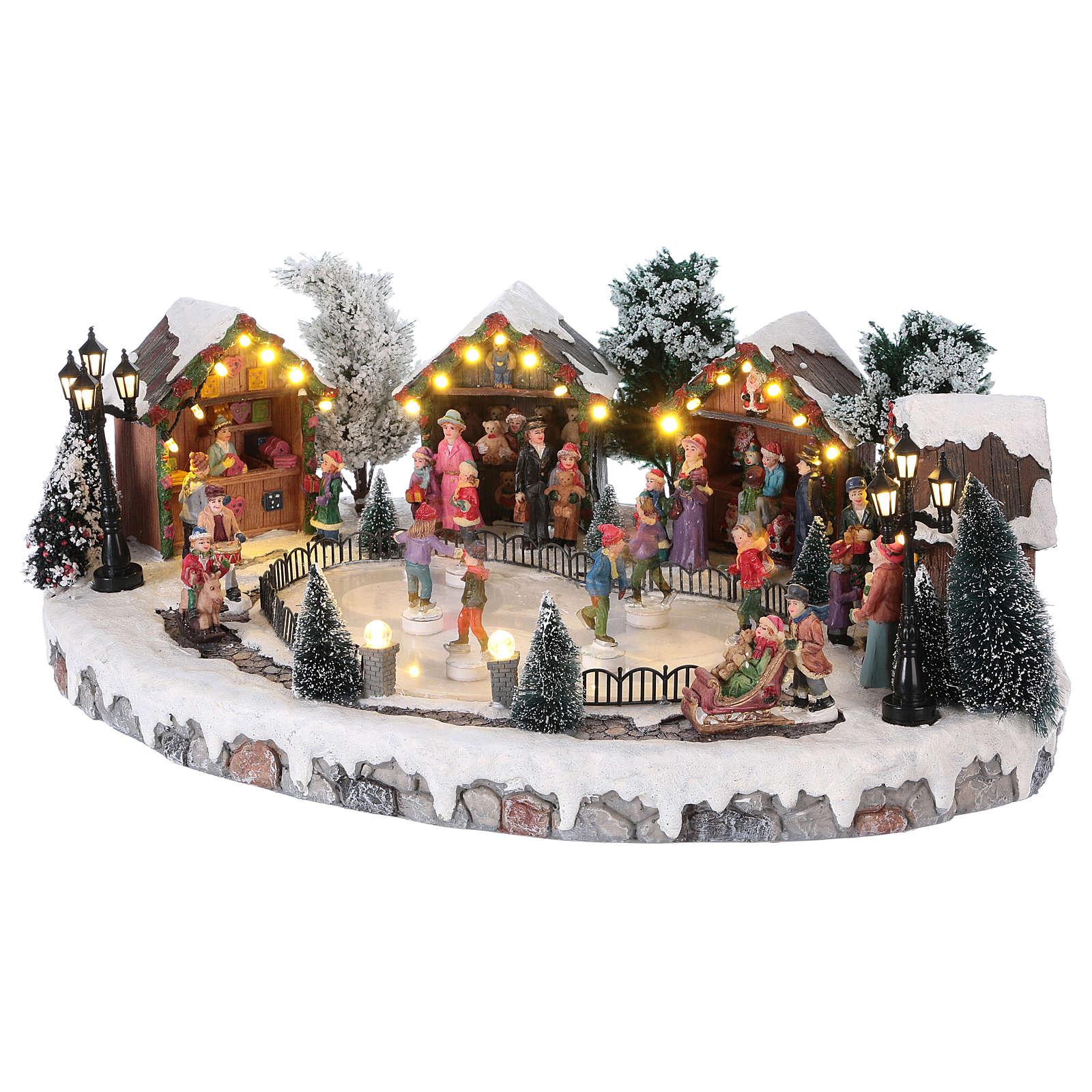 Pueblo de Navidad pista de patinaje luces música movimiento 20x45x30 cm corriente 3