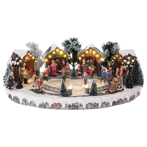 Pueblo de Navidad pista de patinaje luces música movimiento 20x45x30 cm corriente 1