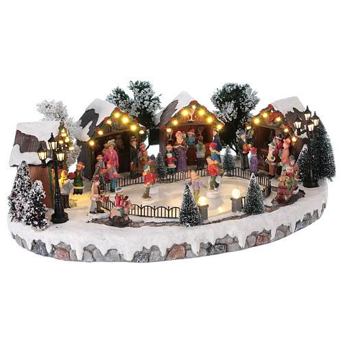 Pueblo de Navidad pista de patinaje luces música movimiento 20x45x30 cm corriente 4