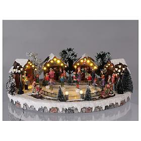 Villaggio di Natale pista pattinaggio luci musica movimento 20x45x30 cm corrente s2