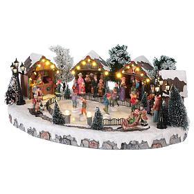 Villaggio di Natale pista pattinaggio luci musica movimento 20x45x30 cm corrente s3