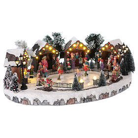 Villaggio di Natale pista pattinaggio luci musica movimento 20x45x30 cm corrente s4