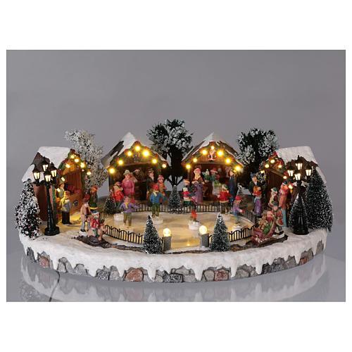 Villaggio di Natale pista pattinaggio luci musica movimento 20x45x30 cm corrente 2
