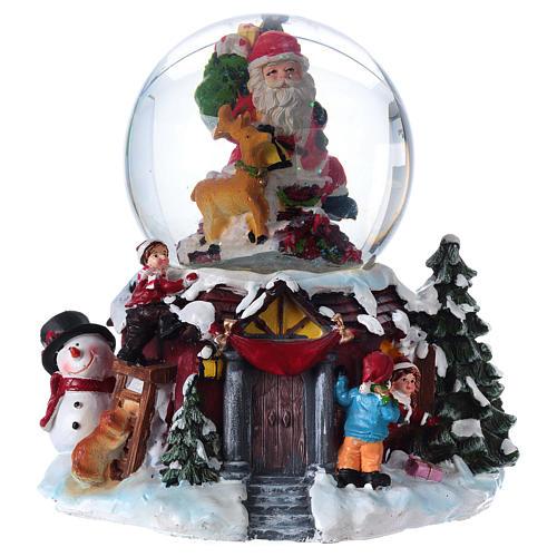 Bola vidrio con nieve y purpurina Papá Noel música y luz 1