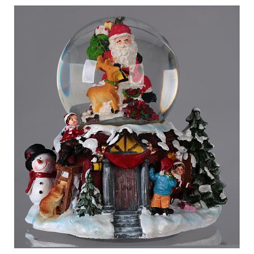 Bola vidrio con nieve y purpurina Papá Noel música y luz 2