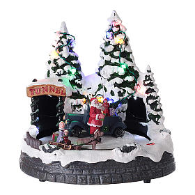 Santa Claus Christmas village children on sled lighted music 20x20x15 cm s1