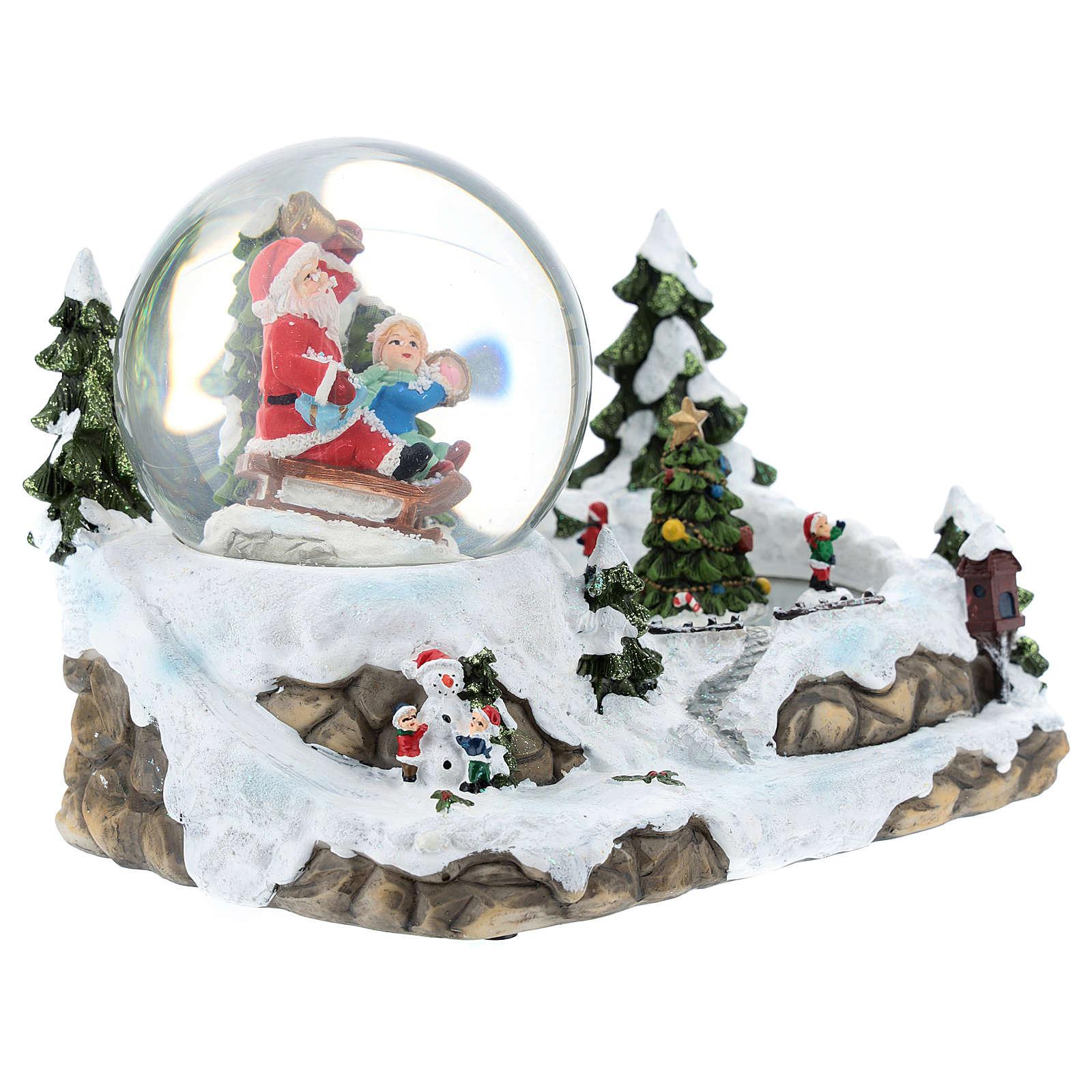 Bola de vidrio con Papá Noel en ambientación 15x20x15 cm 3
