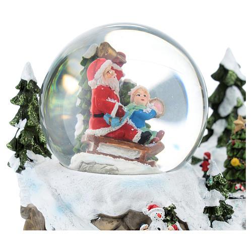 Palla di vetro con Babbo Natale in ambientazione 15x20x15 cm 2
