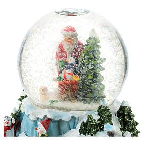 Boule en verre avec Père Noël et traîneau h 15 cm s5