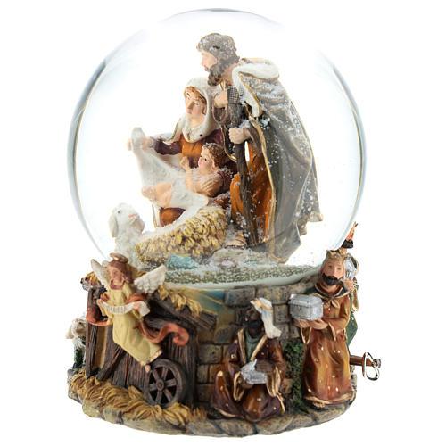 Palla di vetro natalizia con Natività e carillon h. 20 cm 3