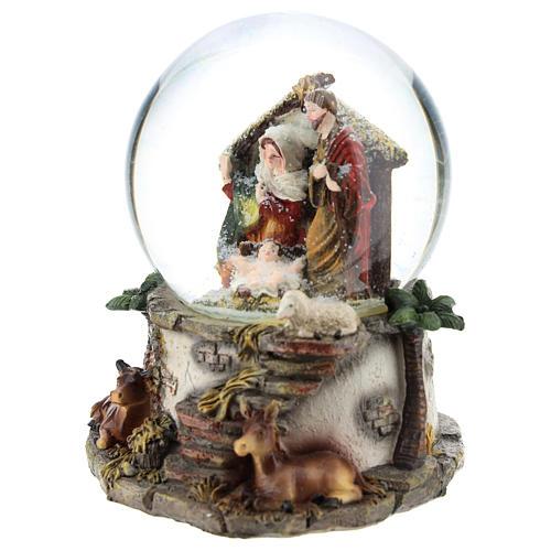 Schneekugel mit Heiliger Familie und Spieldose, 15 cm hoch 3
