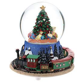Bola de Cristal Navideña: Bola de nieve con árbol de Navidad y tren carillón h. 15 cm