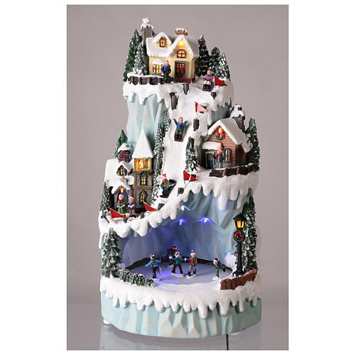Christmas village in resin 43x24 cm with moving ice skating rink 2