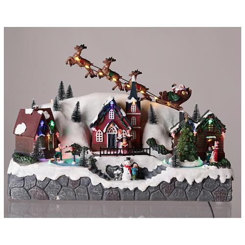 Weihnachtsdorf mit Weihnachtmann im Schlitten, aus Kunstharz, 25x40x20 cm 2