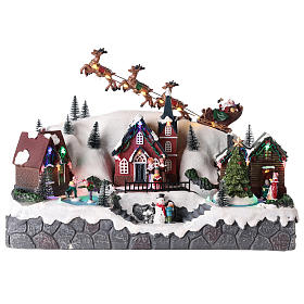 Christmas village with Santa Claus on a moving sleigh 25x40x20 cm s1