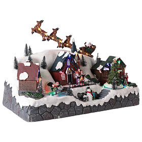 Christmas village with Santa Claus on a moving sleigh 25x40x20 cm s4