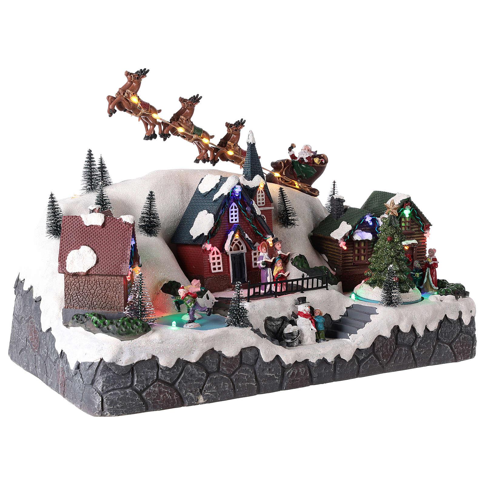 Pueblo de Navidad con trineo de Papá Noel de resina 25x40x20 cm 3