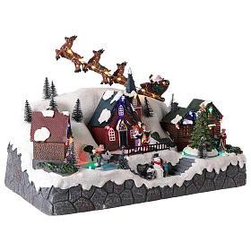 Pueblo de Navidad con trineo de Papá Noel de resina 25x40x20 cm s4