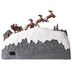 Pueblo de Navidad con trineo de Papá Noel de resina 25x40x20 cm s5