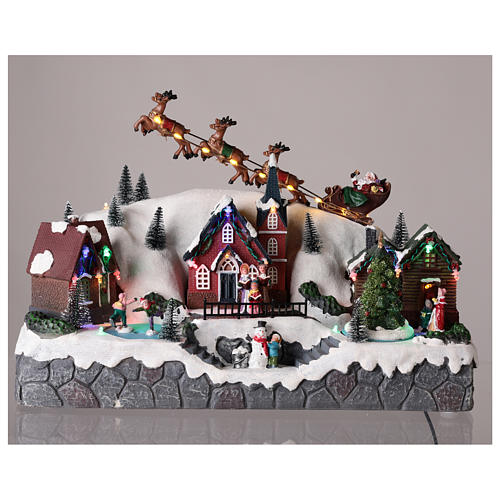 Pueblo de Navidad con trineo de Papá Noel de resina 25x40x20 cm 2