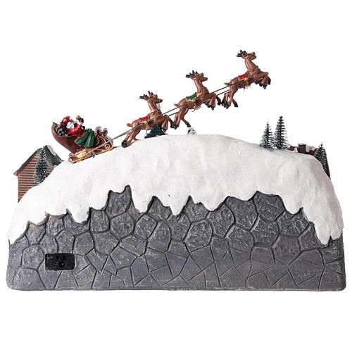 Pueblo de Navidad con trineo de Papá Noel de resina 25x40x20 cm 5