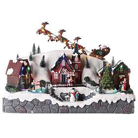 Villages de Noël miniatures: Village de Noël avec traîneau de Père Noël en résine 25x40x20 cm