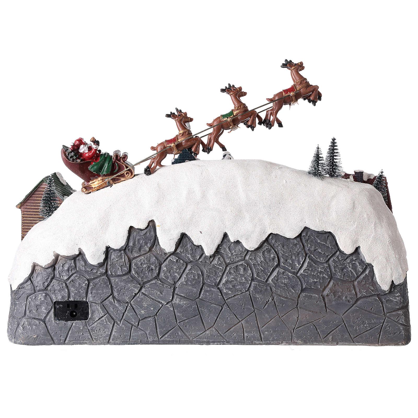 Villaggio di Natale con slitta di Babbo Natale in resina 25x40x20 cm 3