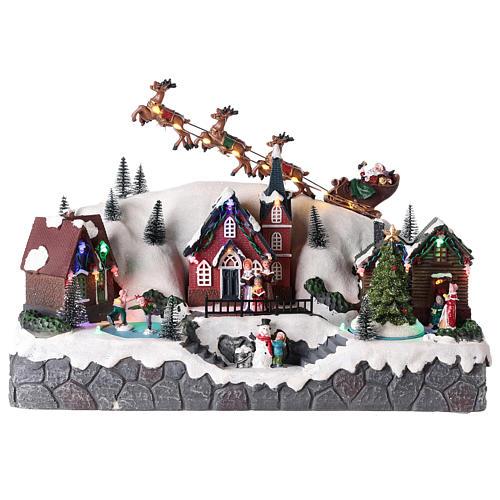 Villaggio di Natale con slitta di Babbo Natale in resina 25x40x20 cm 1
