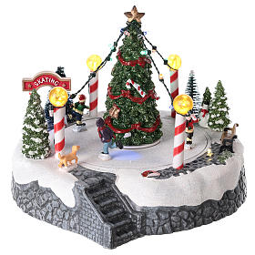 Round village with central tree and revolving skating rink 20x22 cm s1