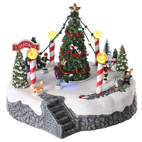 Round village with central tree and revolving skating rink 20x22 cm 1