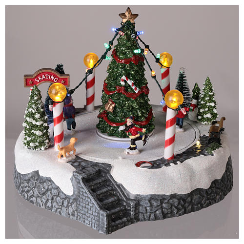 Round village with central tree and revolving skating rink 20x22 cm 2