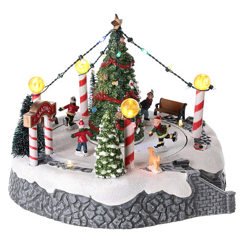 Round village with central tree and revolving skating rink 20x22 cm 4