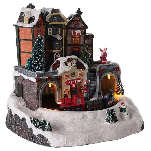 Villaggio di Natale con treno in movimento 20x15 cm 4