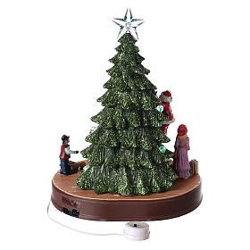 Papá Noel con árbol para pueblo con música e iluminaciones 30x25x20 cm s5