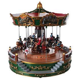 Carrousel pour village de Noël avec éclairage mouvement et musique 30x30 cm s1