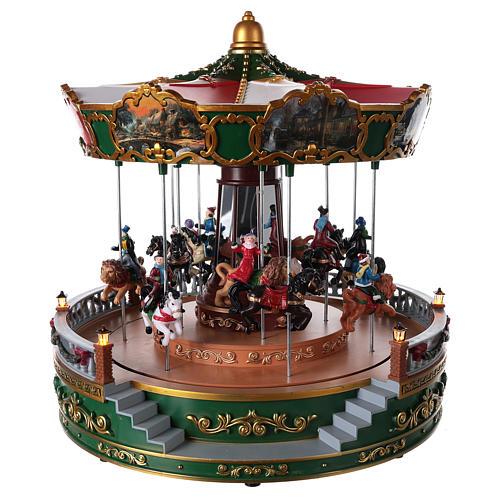 Carrousel pour village de Noël avec éclairage mouvement et musique 30x30 cm  1