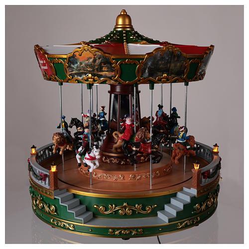 Carrousel pour village de Noël avec éclairage mouvement et musique 30x30 cm 2