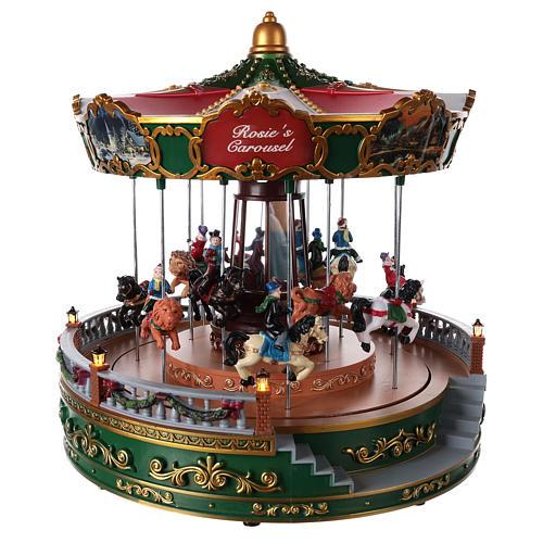 Carrousel pour village de Noël avec éclairage mouvement et musique 30x30 cm 4