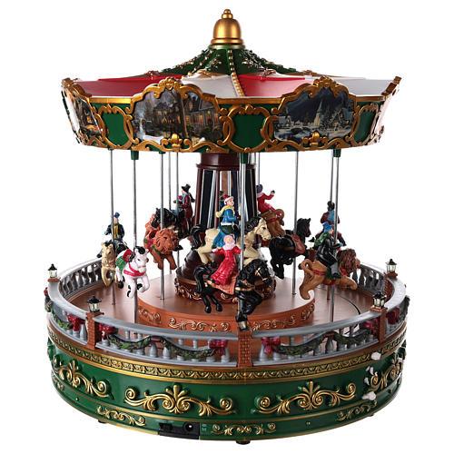 Carrousel pour village de Noël avec éclairage mouvement et musique 30x30 cm 5