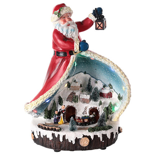 Statue of Santa Claus with village 30x20x15 1