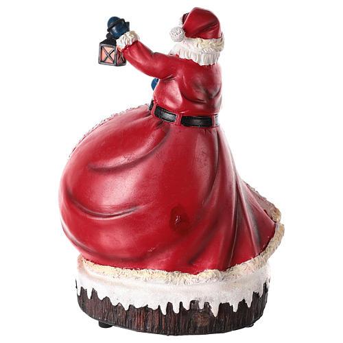 Estatua de Papá Noel con pueblo 30x20x15 5