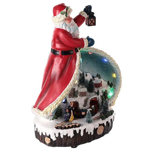 Statua di Babbo Natale con villaggio 30x20x15 4